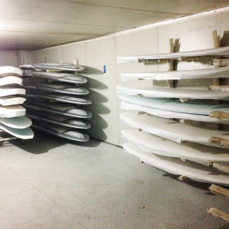 Surfboards 'curing' in temperature controlled room