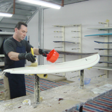 Jeff Townsley glassing one of his boards Circa 2016