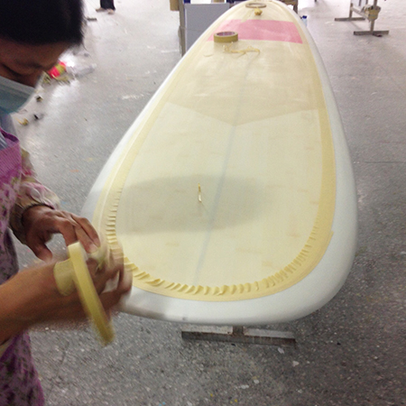 masking tape applied to surfboard ready for spray design